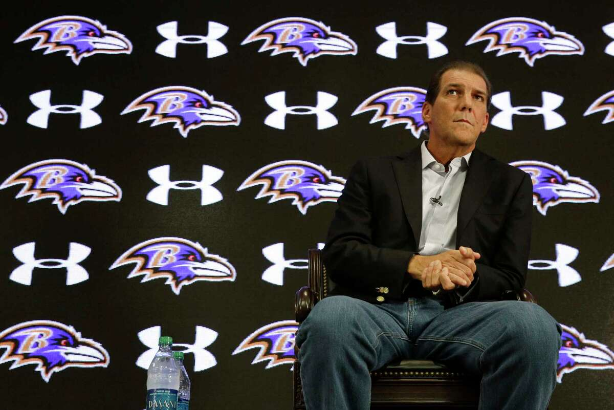 Baltimore Ravens owner Steve Bisciotti listens to a reporter's question at a news conference on Monday.