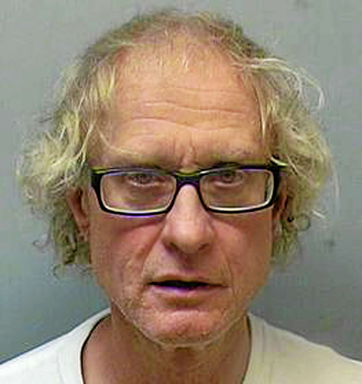 This booking photo released by the Wethersfield Police Department shows John Waszynski, arrested Thursday, May 22, 2014, and charged with murder and cruelty to persons after the decomposed body of his 86-year-old mother, Krystyna Waszynski, was found in their Wethersfield home. (AP Photo/Wethersfield Police Department)