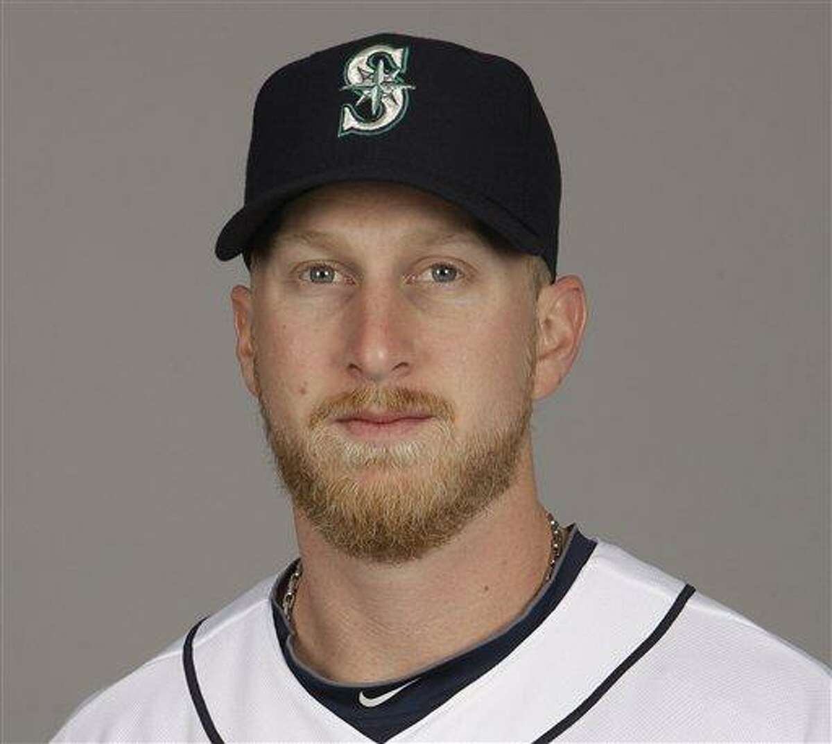 IFLE - In this 2012 file photo, Mike Carp of the Seattle Mariners baseball team poses in Peoria, Ariz. The Boston Red Sox have acquired Carp from the Mariners for a player to be named later or cash. Seattle designated the 26-year-old Carp for assignment earlier this month, and the Red Sox were able to work out a deal for him. Carp can play both first base and left field. Boston and Seattle announced the move Wednesday, Feb. 20, 2013. (AP Photo/Charlie Riedel, File)