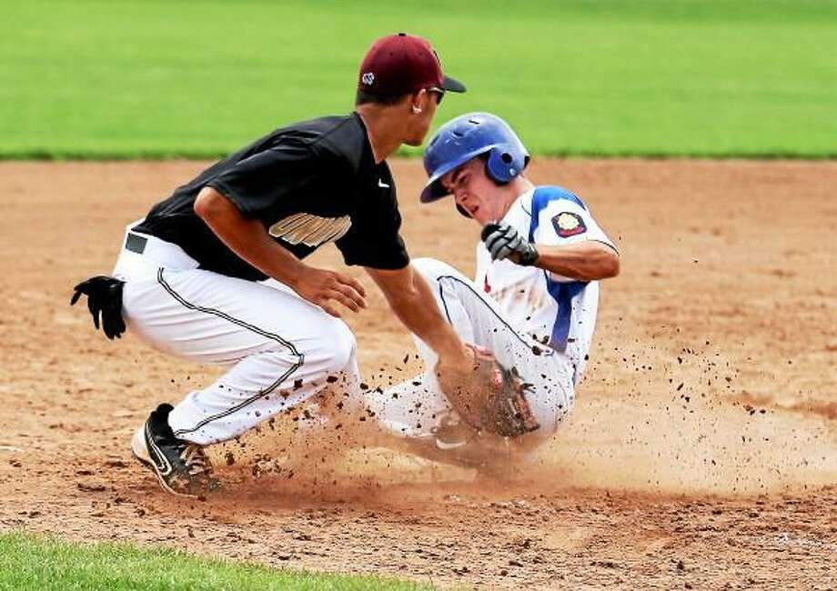 Tom Jerram of the Torrington P38s slides into third base safely. Marianne Killackey/Special to Register Citizen / 2013