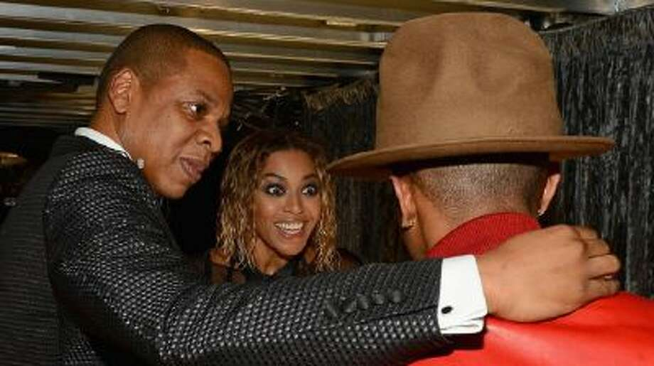 Musicians Jay-Z, Beyonce, and Pharrell Williams attend the 56th Grammy Awards at Staples Center on Jan. 26, 2014 in Los Angeles.