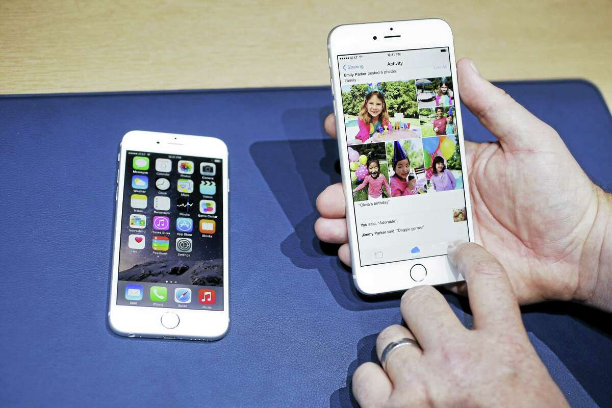 In this Sept. 9, 2014 photo, the iPhone 6, at left, and iPhone 6 plus are shown next to each other during a new product release in Cupertino, Calif. Appleís new and bigger iPhone 6 and iPhone 6 Plus are more durable than last yearís model and a leading Android phone, a study says.
