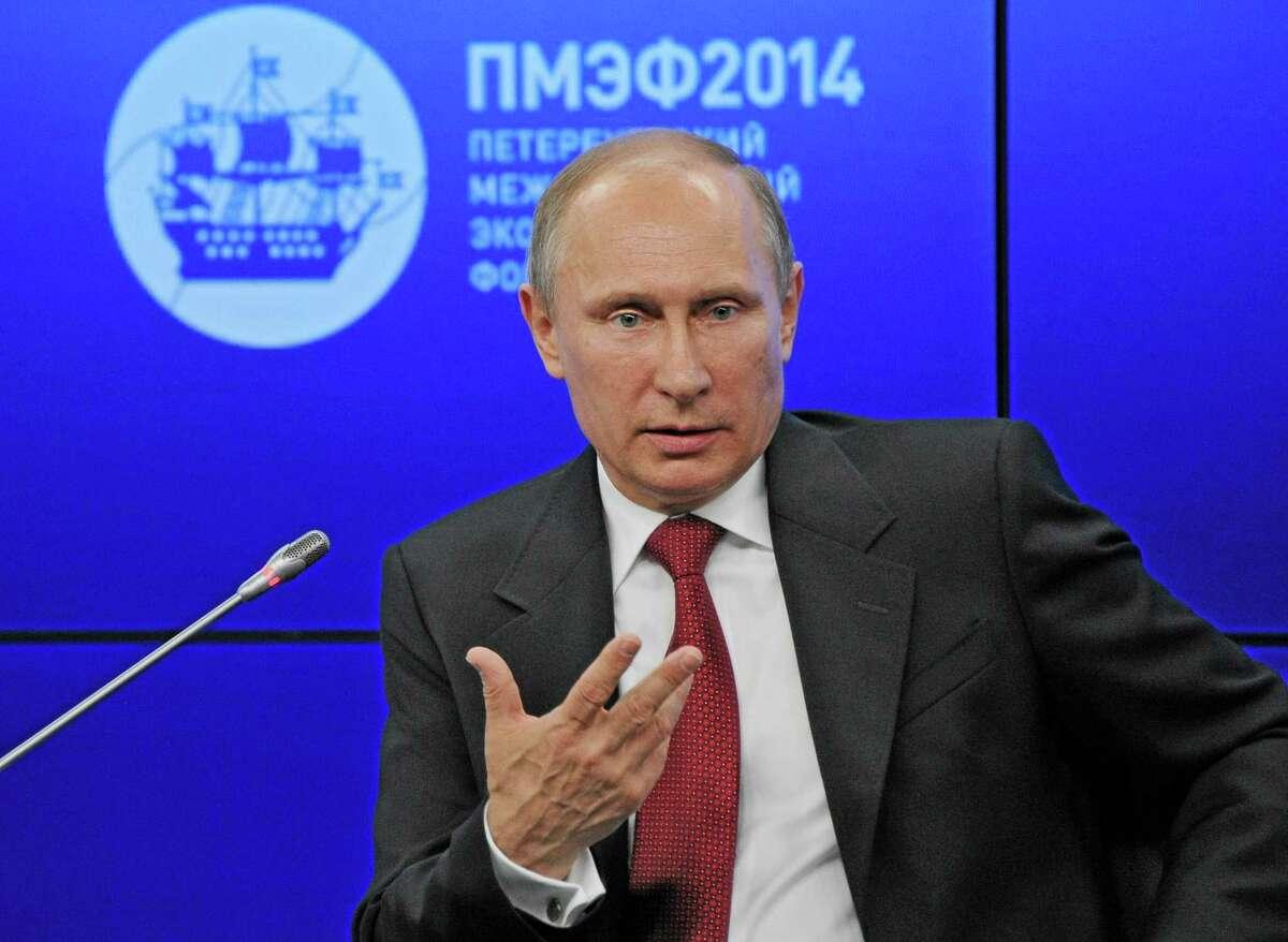 Russian President Vladimir Putin speaks during a plenary session of the St. Petersburg International Investment Forum Friday, May 23, 2014. Putin said Friday at an investment forum that Russia will