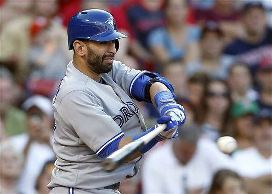 Toronto Blue Jays' Jose Bautista hits an RBI double in the ninth inning of a baseball game against the Boston Red Sox in Boston, Saturday, June 29, 2013. Bautista was out trying to advance to third. The Blue Jays won 6-2. (AP Photo/Michael Dwyer) Photo: AP / AP