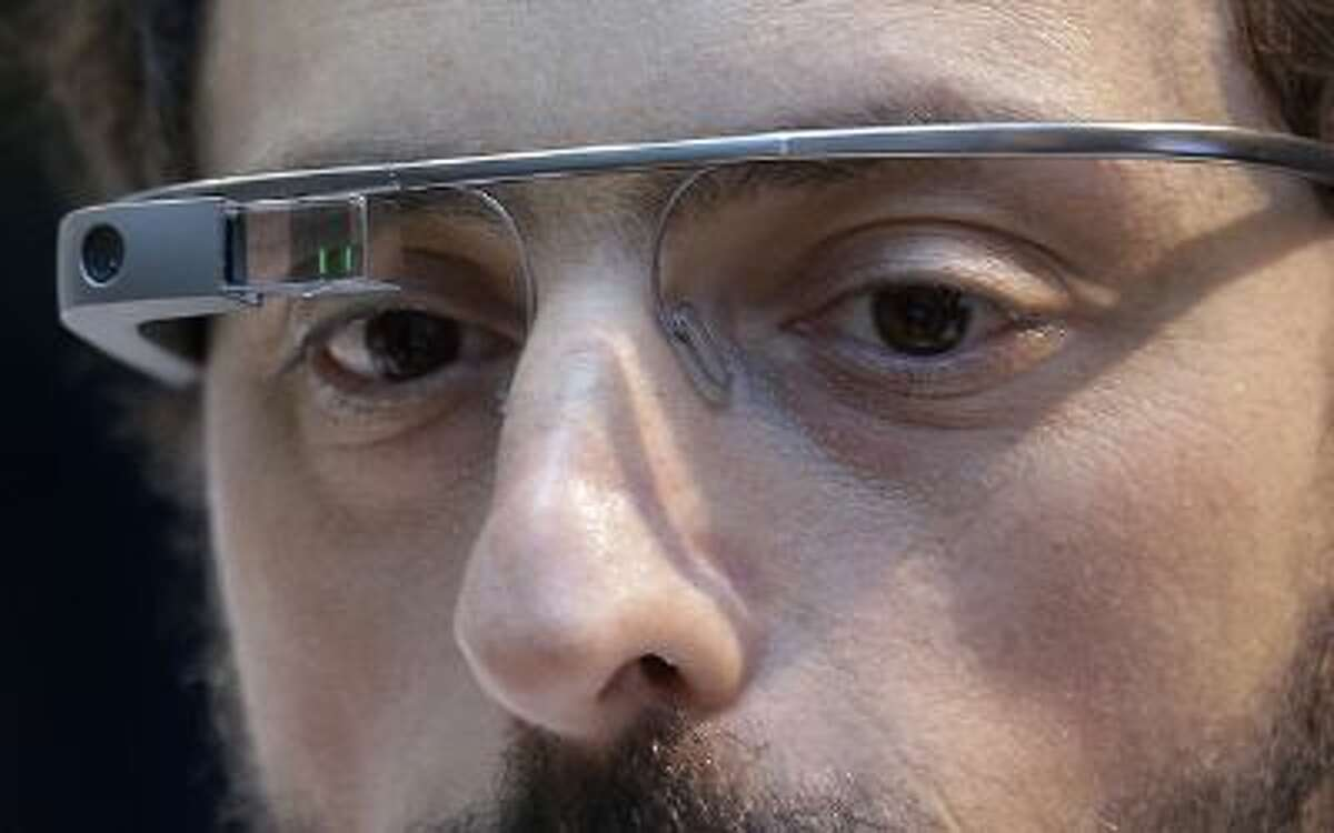 Google co-founder Sergey Brin wears Google Glass glasses at an announcement for the Breakthrough Prize in Life Sciences at Genentech Hall on UCSF's Mission Bay campus in San Francisco, Wednesday, Feb. 20, 2013.