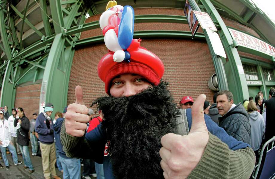 Michael Mahoney waits in line for tickets outside of Fenway Park before Game 6 of the World Series between the Red Sox and the St. Louis Cardinals on Wednesday in Boston. Photo: Charlie Riedel — The Associated Press  / AP