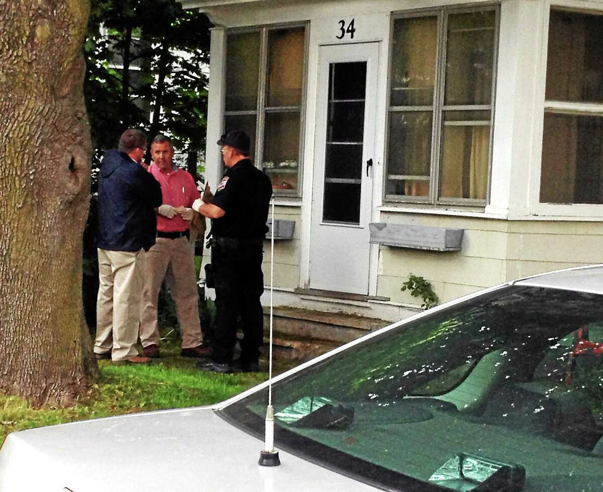 Torrington Police investigate an untimely death in front of 34 North Elm St., one of the city's sober houses, Friday.