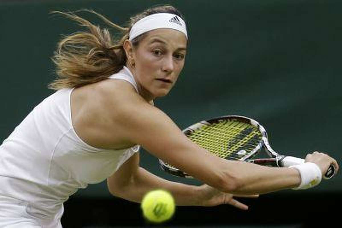 Mariana Duque-Marino of Colombia plays a return to Laura Robson of Britain during their Women's second round singles match at the All England Lawn Tennis Championships in Wimbledon, London, Friday, June 28, 2013. (AP Photo/Anja Niedringhaus)