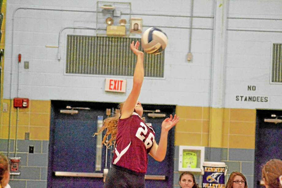 Torrington's Jenna Gyuricsko gets one of her three kills in Torrington's 3-1 loss to Woodland. Photo: Pete Paguaga — Register Citizen