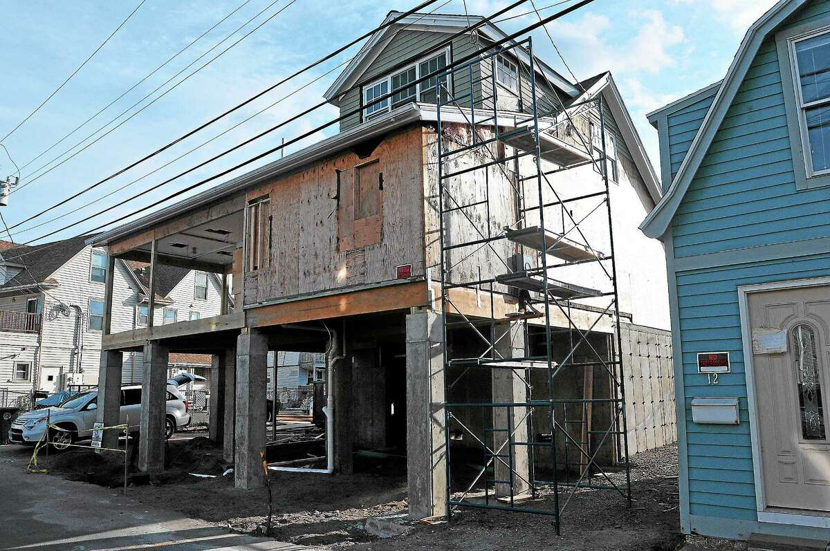 Homes along Cooper Avenue in Milford damaged during storm Sandy in a file photo.