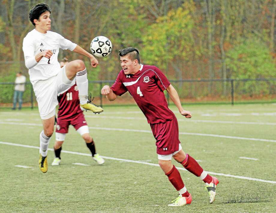 Torrington's John McCarthy heads the ball in the Red Raiders 4-1 loss to Naugatuck. Photo: Marianne Killackey — Special To The Register Citizen  / 2013