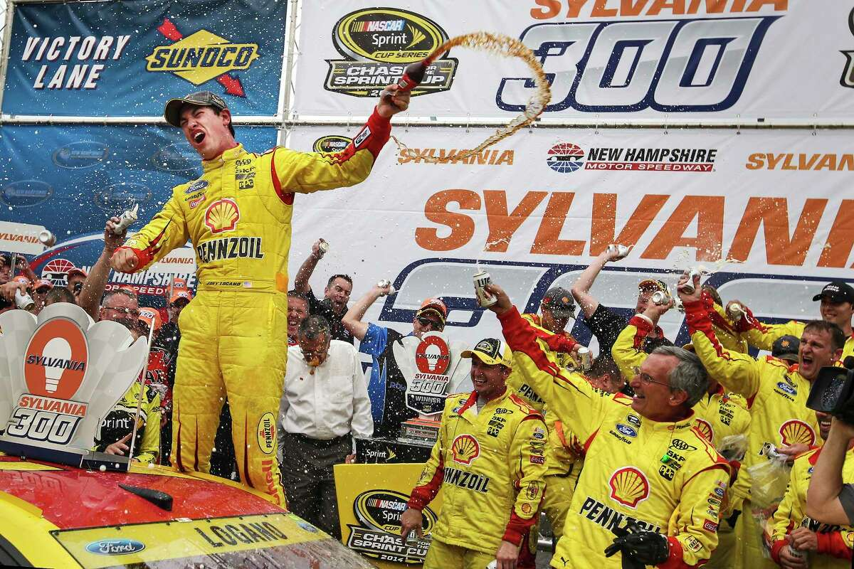 Joey Logano celebrates in victory lane after winning at New Hampshire Motor Speedway on Sunday.