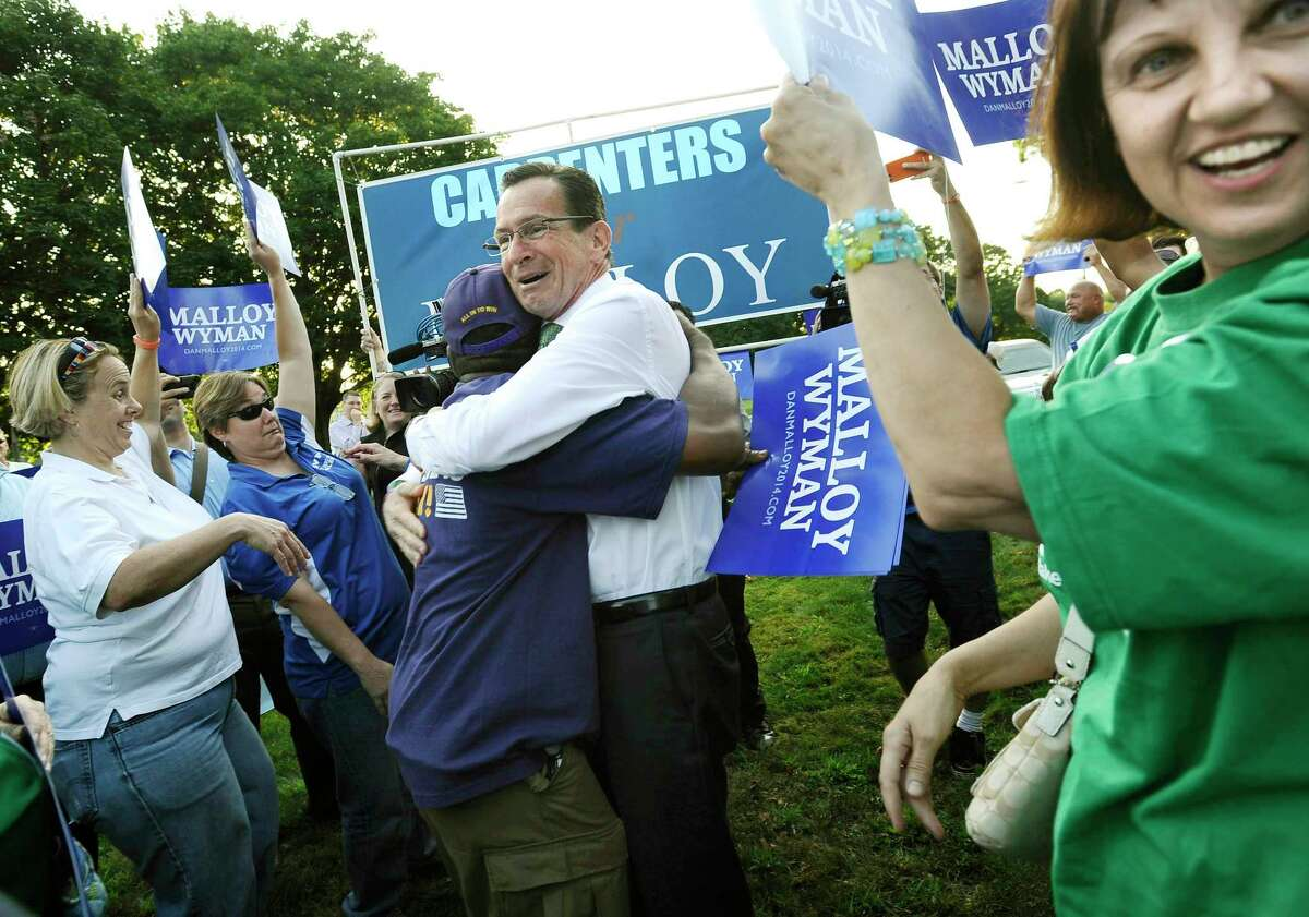 In this Aug. 27, 2014 photo, Democratic Gov. Dannel P. Malloy, greets supporters at a rally prior to a debate against Republican opponent Tom Foley in Norwich, Conn. A Sept. 10 Quinnipiac University Poll, when broken down by gender, determined 45 percent of women polled supported Malloy, compared to 38 percent for Foley and nine percent for conservative petitioning candidate Joe Visconti.