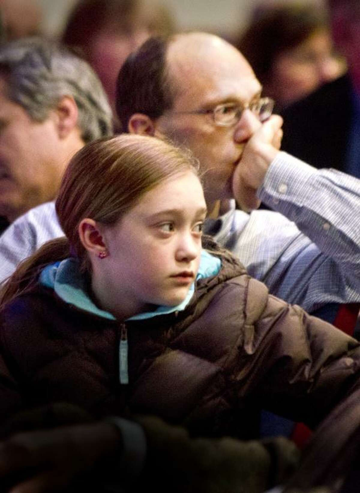Waterbury--Monte Frank, and his daughter Sarah Frank,11, of Sandy Hook listen to people speaking from the crowd gathered for a Town Hall meeting on guns. The meeting, held by Congresswoman Elizabeth Esty, took place at Rotella Interdistrict Magnet School. Sarah was taught by slain Sandy Hook teacher, Victoria Soto. Melanie Stengel/Register