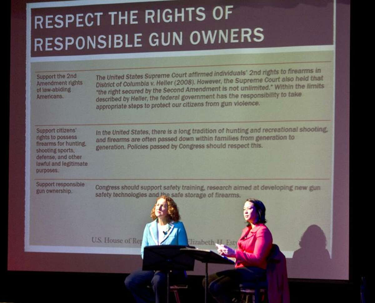 Waterbury--Congresswoman Elizabeth Esty (L) and Moderator, Laurie Perez, of FOX Connecticut, speak to the crowd gathered for a Town Hall meeting on guns. The meeting, held by Congresswoman Elizabeth Esty, took place at Rotella Interdistrict Magnet School. taught by Melanie Stengel/Register