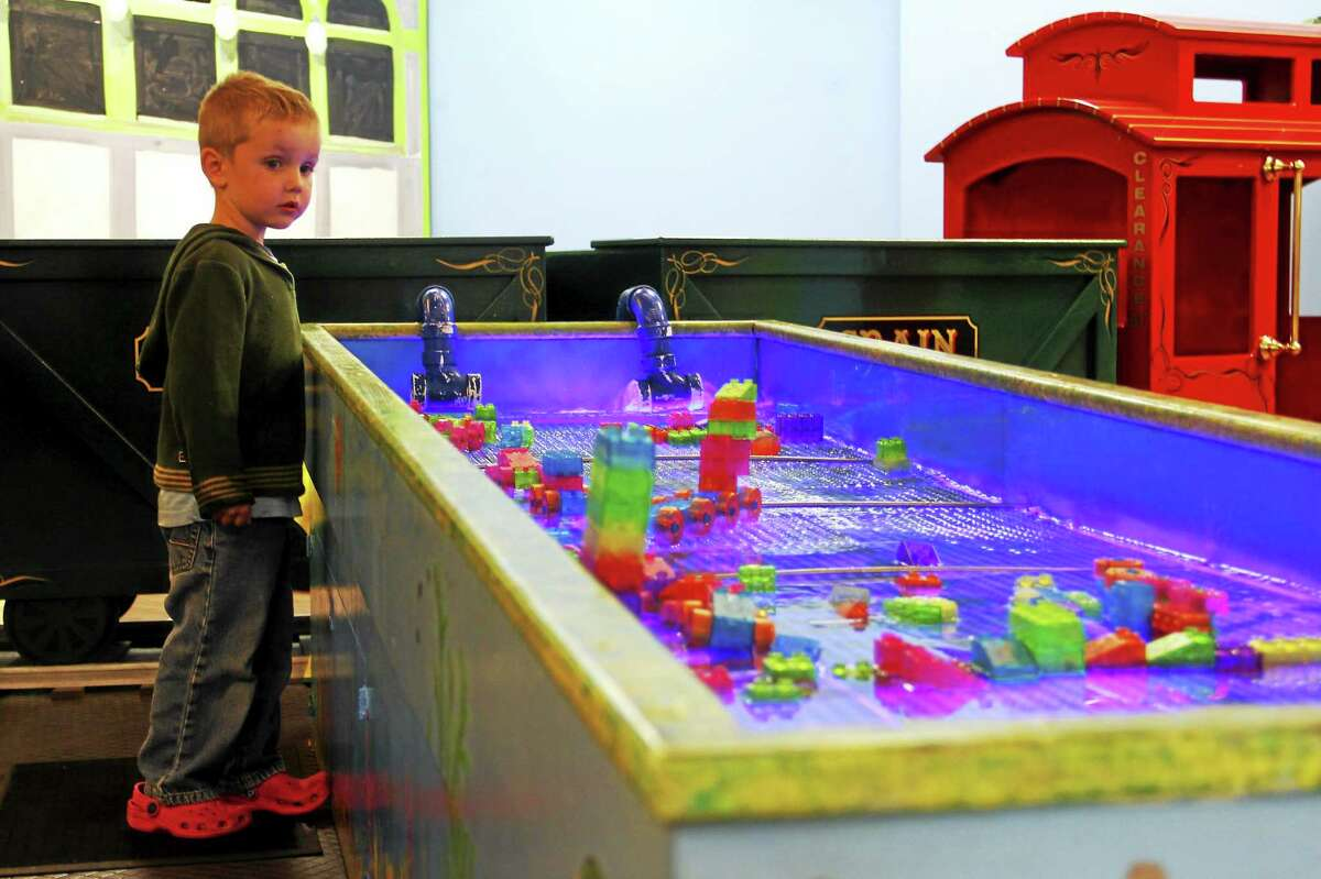 A child looks at an exhibit at KidsPlay on Friday, Sept. 19, in downtown Torrington. Esteban L. Hernandez Register Citizen