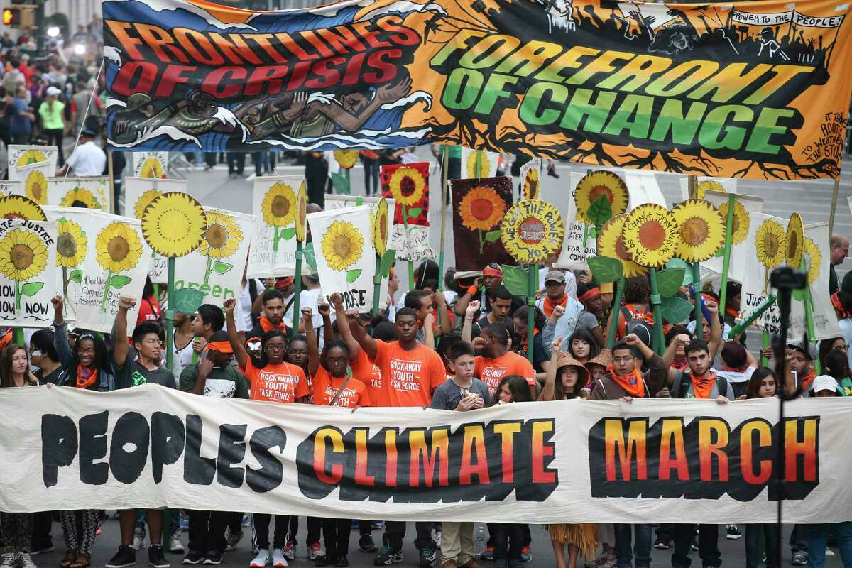 More than 100,000 people march through midtown Manhattan on Sept. 21, 2014 as part of the People's Climate March, a worldwide mobilization calling on world leaders meeting at the UN to commit to urgent action on climate change and 100% clean energy in New York.
