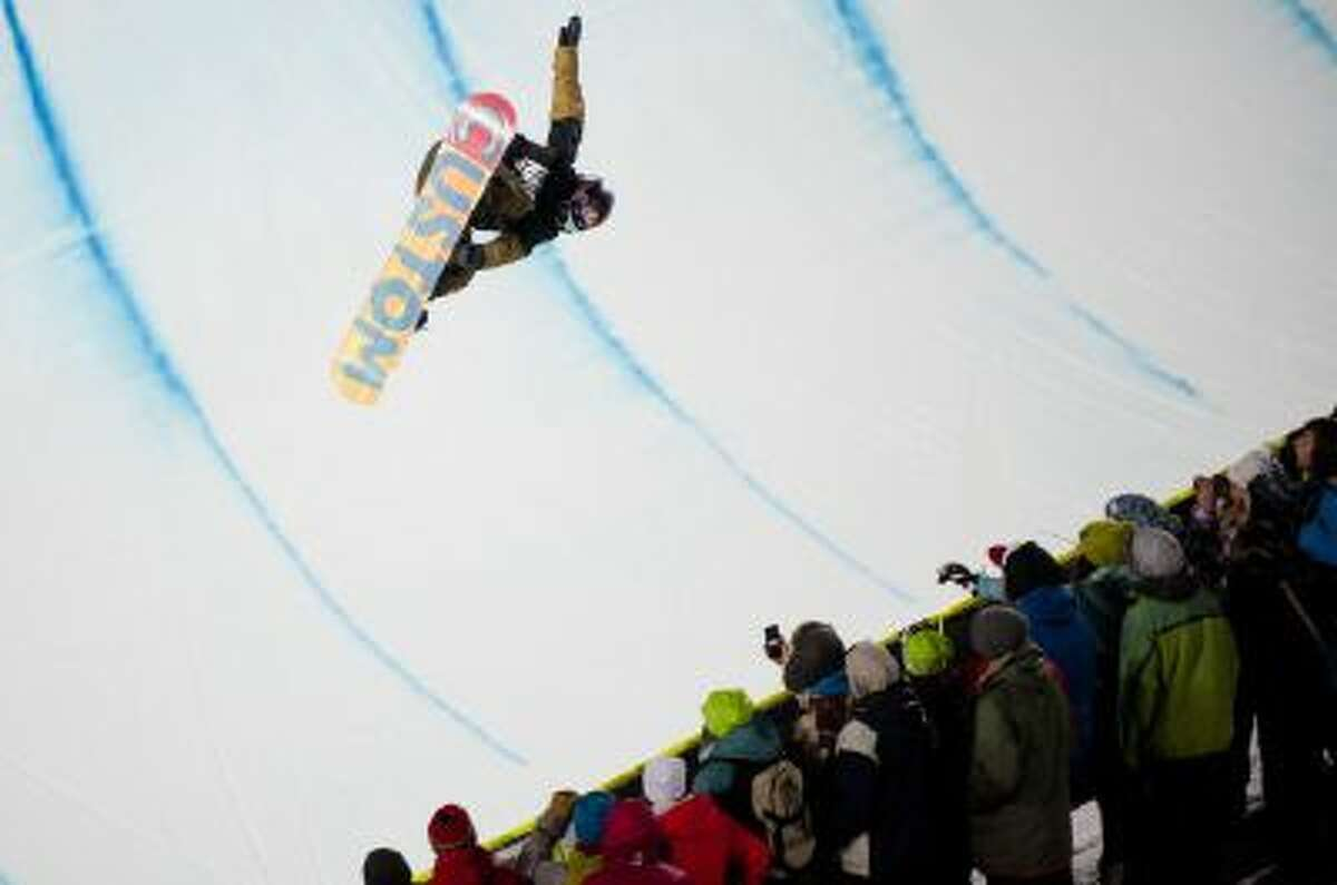 Ben Ferguson soars above the half pipe during the Men's Snowboard SuperPipe finals at the 18th edition of the Winter X Games in Aspen, Colo. Sunday, Jan. 26, 2014.