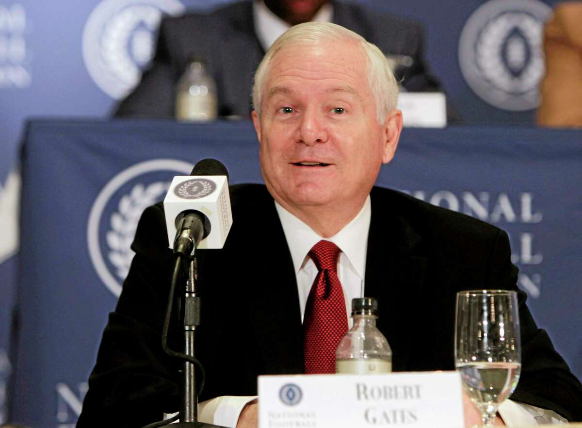 In this Dec. 6, 2011, file photo former U.S. Secretary of Defense Robert Gates speaks during a news conference in New York. The Boy Scouts of America confirmed Gates as its new president on Thursday, May 22, 2014 at the organization's annual meeting in Nashville.