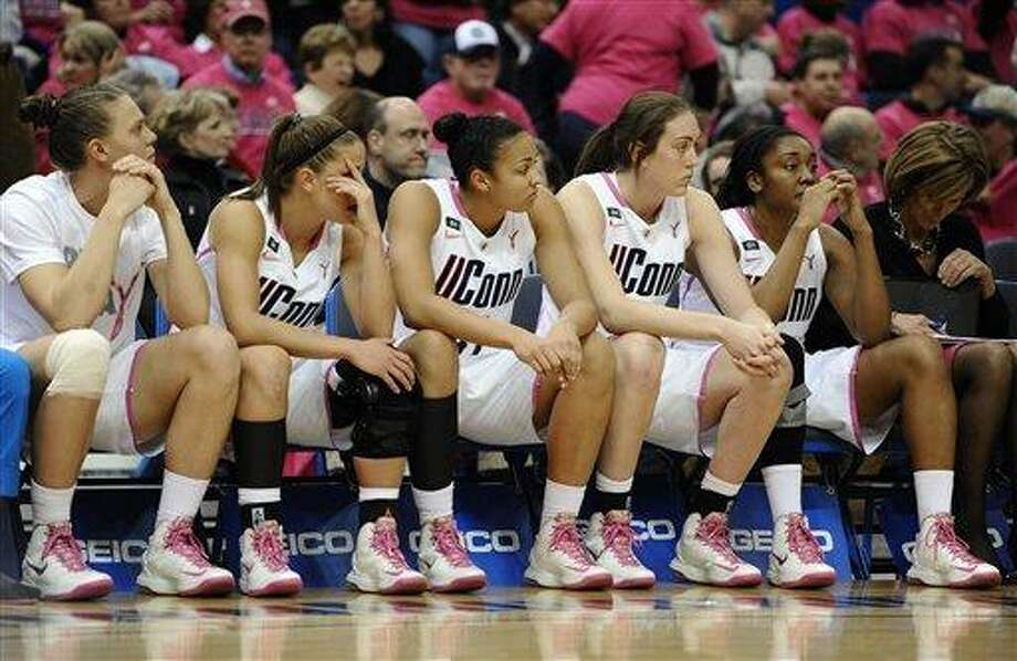 Connecticut players, from left, Heather Buck, Caroline Doty, Kiah Stokes, Breanna Stewart, Morgan Tuck and associate head coach Chris Daily watch play late the second half of an NCAA college basketball game against Baylor in Hartford, Conn., Monday, Feb. 18, 2013. Baylor won 76-70. (AP Photo/Jessica Hill) Photo: AP / FR125654 AP