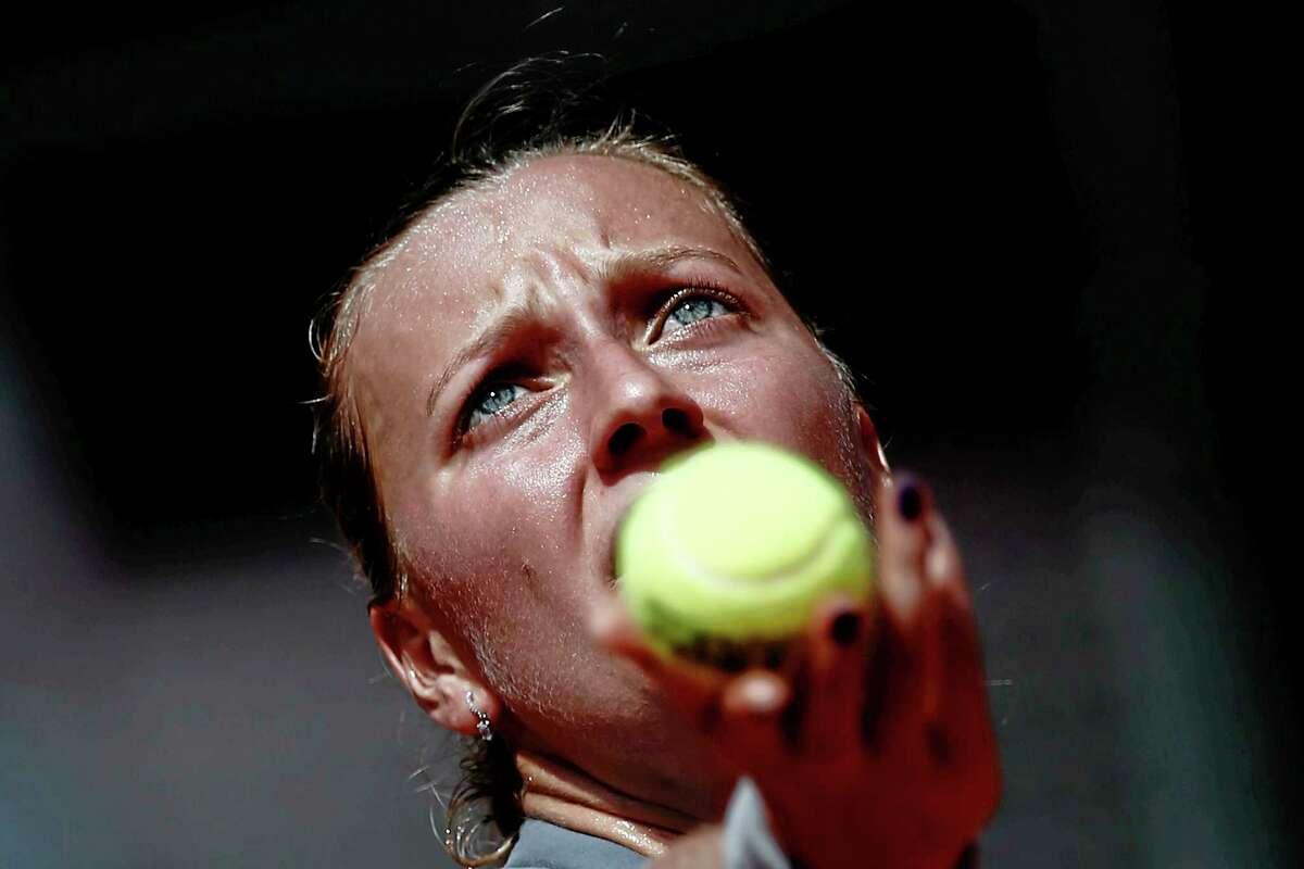 Petra Kvitova serves to Simona Halep during the Madrid Open in Madrid, Spain, on May 10.