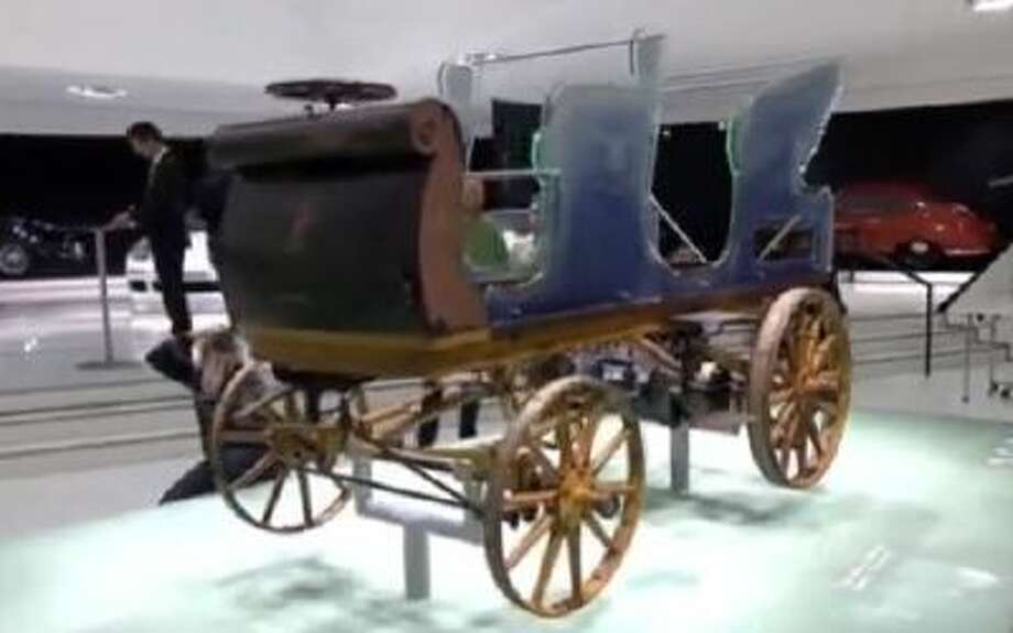 A P1, the first Porsche construction from 1898, on display at the Porsche Museum in Stuttgart, Germany, Jan. 27, 2014.