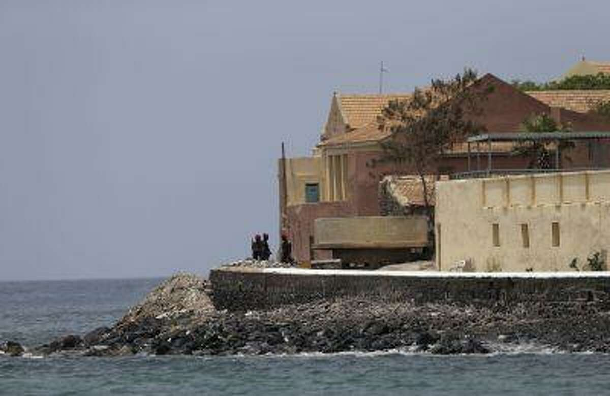 Senegalese soldiers stand guard near the slave house on Goree Island, ahead of a visit by U.S. President Barack Obama, in Dakar, Senegal, Thursday, June 27, 2013. Obama is calling his visit to a Senegalese island from which Africans were said to have been shipped across the Atlantic Ocean into slavery, a 'very powerful moment.' President Obama was in Dakar Thursday as part of a weeklong trip to Africa, a three-country visit aimed at overcoming disappointment on the continent over the first black U.S. president's lack of personal engagement during his first term.(AP Photo/Rebecca Blackwell)
