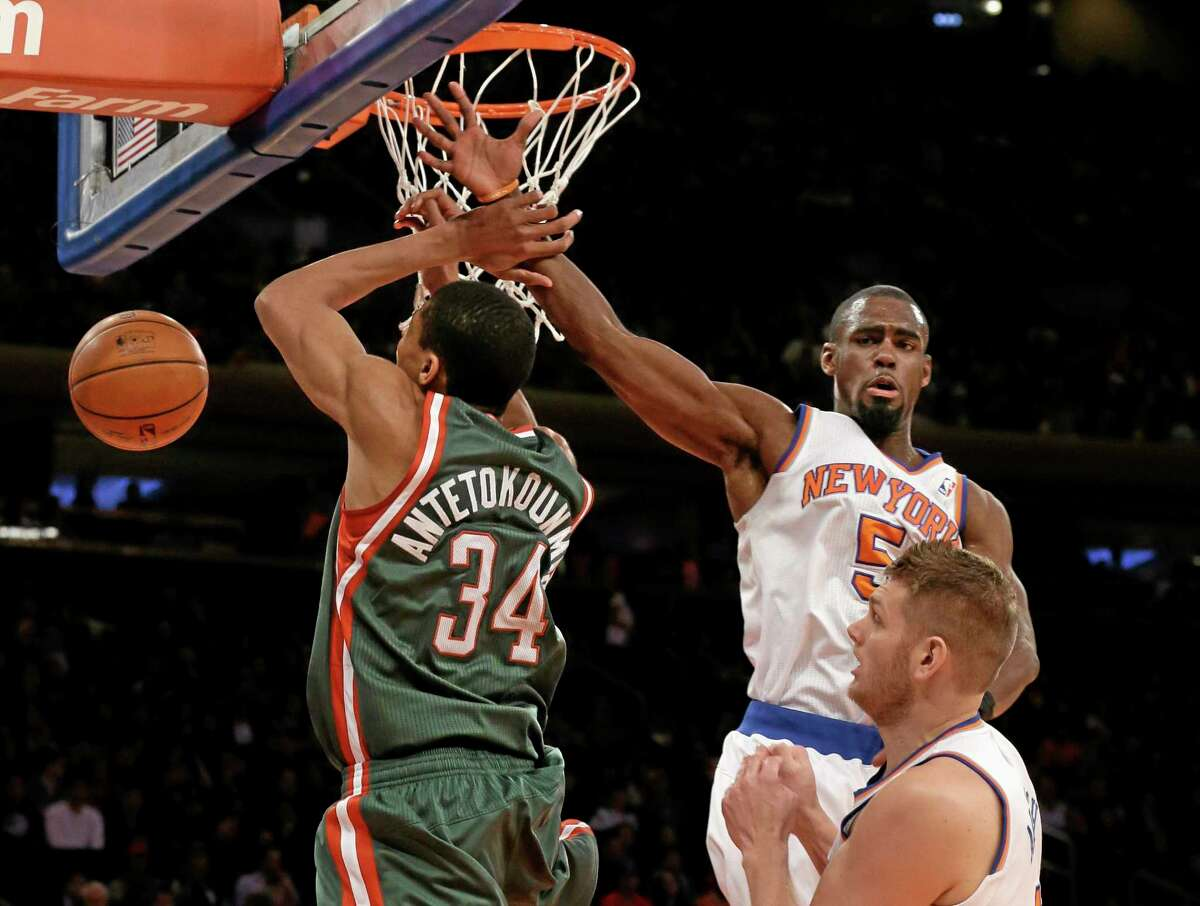 The Milwaukee Bucks' Giannis Antetokounmpo has his shot blocked by the Knicks' Tim Hardaway Jr. during a March 15 game at Madison Square Garden in New York.