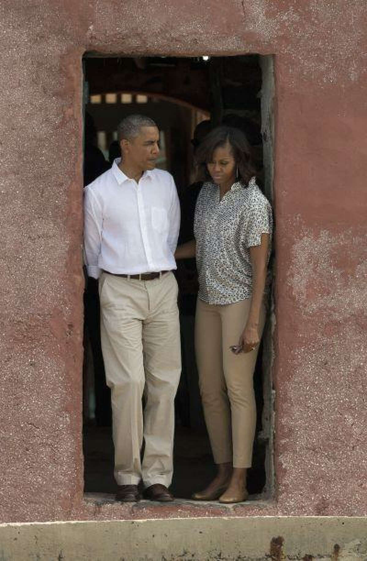 U.S. President Barack Obama and first lady Michelle Obama stand together at the 'Door of No Return,' at the slave house on Goree Island, in Dakar, Senegal, Thursday, June 27, 2013. Obama is calling his visit to a Senegalese island from which Africans were said to have been shipped across the Atlantic Ocean into slavery, a 'very powerful moment.' He was in Dakar Thursday as part of a weeklong trip to Africa, a three-country visit aimed at overcoming disappointment on the continent over the first black U.S. president's lack of personal engagement during his first term.(AP Photo/Rebecca Blackwell)