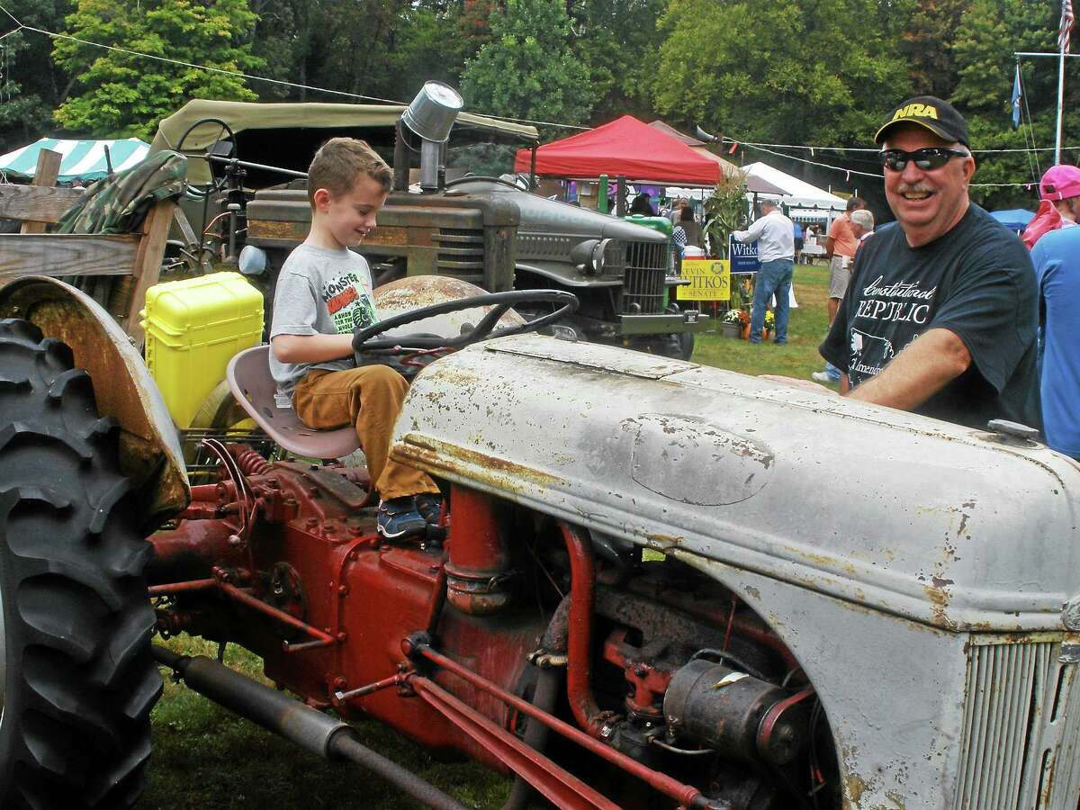 The 41st annual New Hartford Day and Eureka Grange Fair drew nearly 70 vendors with local participation and high turnout despite overcast skies and rainfall.