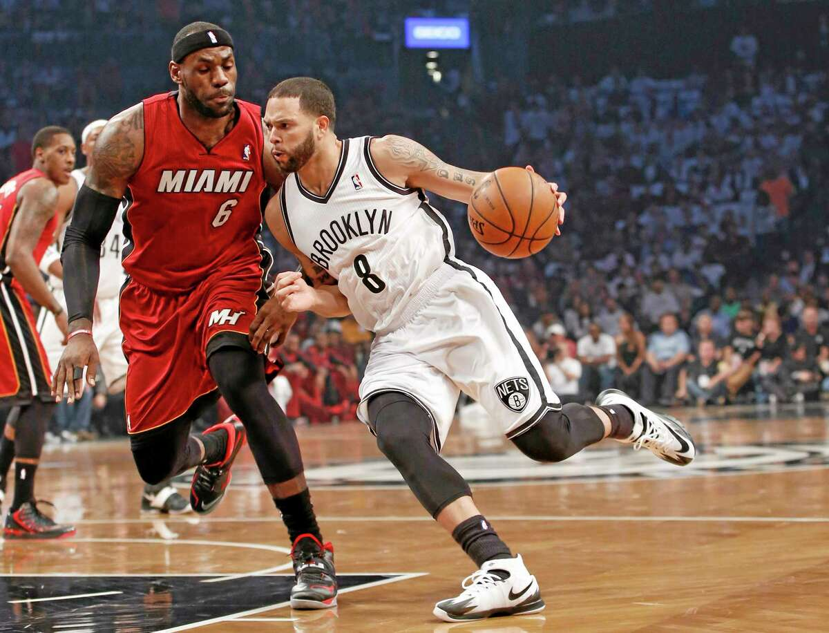 Nets guard Deron Williams drives around Miami Heat forward LeBron James during Game 4 of their second-round playoff series on May 12 in Brooklyn.