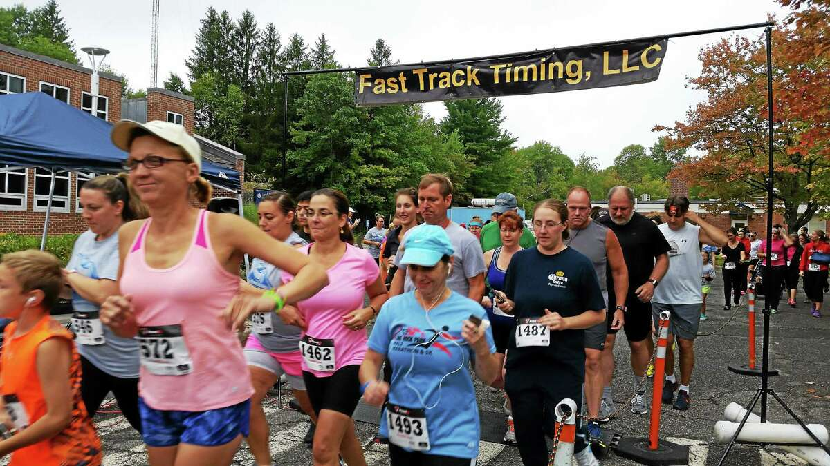 Runners compete at Sunday's Mile 4 Moe 5K race at the University of Connecticut Torrington campus, which raises money for Camp Moe and encourages inclusive activities for children with special needs.