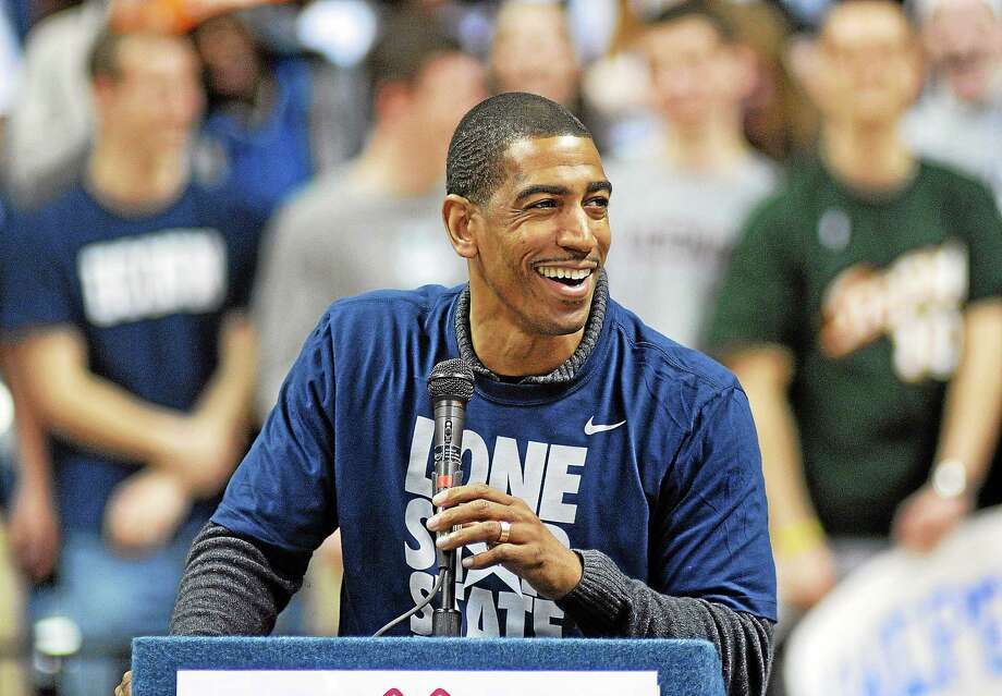 UConn men's basketball coach Kevin Ollie speaks during a ceremony at Gampel Pavilion after returning home with the national championship. Photo: Peter Casolino — Register File Photo