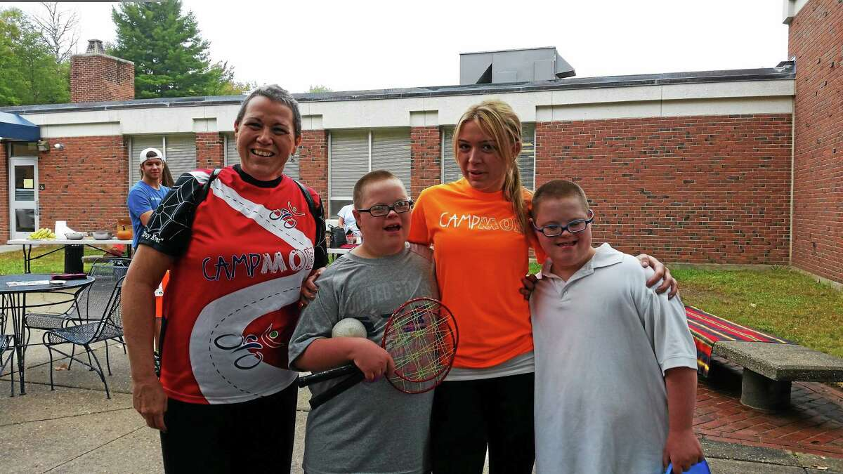 Colleen Renzullo, 52, of Torrington, Daniel Burr, 10, Colleen's daughter Stephanie Renzullo, 21, Caleb Burr, 10, are shown at Sunday's Mile 4 Moe 5K race at the University of Connecticut Torrington campus, to raise money for Camp Moe and encourage inclusive activities for children with special needs.