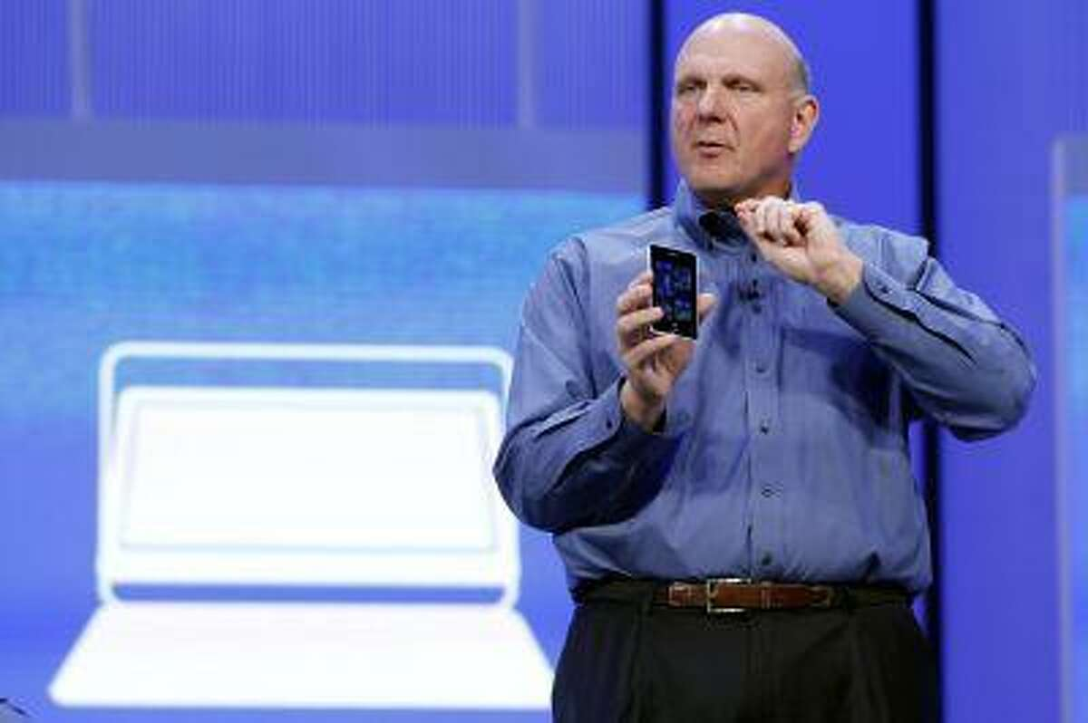 Microsoft CEO Steve Ballmer displays a Windows phone during his keynote address at the Microsoft