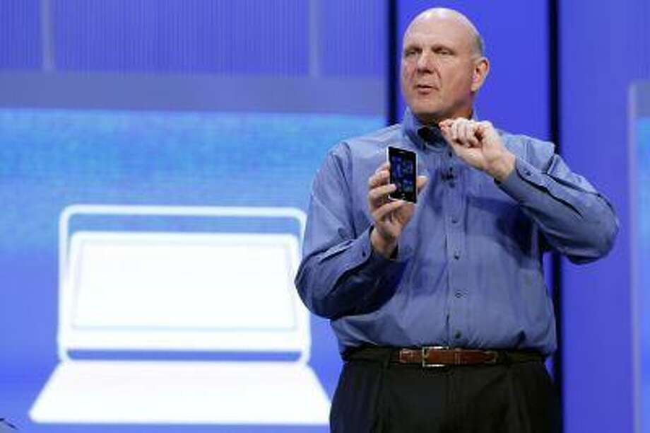 """Microsoft CEO Steve Ballmer displays a Windows phone during his keynote address at the Microsoft """"Build"""" conference in San Francisco, Calif., June 26, 2013. Photo: REUTERS / X90034"""