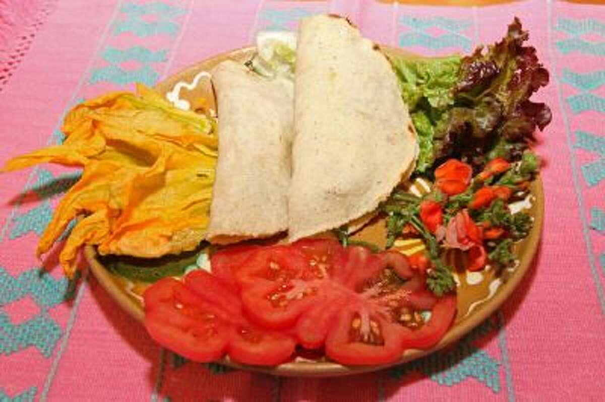 A pair of traditional Mexican quesadillas prepared by students is on display during a Mexican cooking class led by chef Pilar Cabrera, at the Posada de los Milagros B&B in Oaxaca, Mexico.