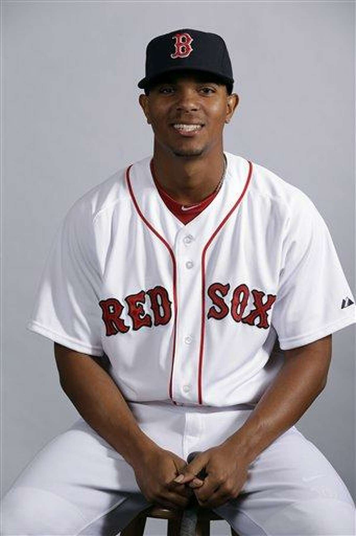 FILE - This Feb. 17, 2013 file photo shows Boston Red Sox's Xander Bogaerts posing during team photo day in Fort Myers, Fla. Bogaerts, Boston's top prospect, is chugging away at his first spring training, doing whatever he can to impress staff and teammates. Either way, though, he'll soon be headed out of town. (AP Photo/Chris O'Meara, File)