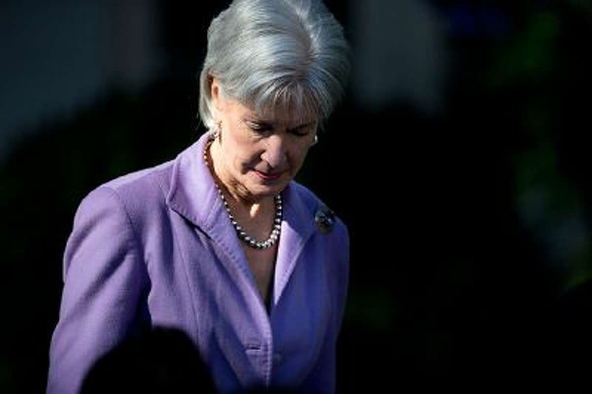 Health and Human Services Secretary Kathleen Sebelius arrives in the Rose Garden of the White House in Washington for and event with President Barack Obama on the initial rollout of the health care overhaul. As the public face of President Barack Obama's signature health care program, Sebelius has become the target for attacks over its botched rollout. Republicans want her to resign and even some Democrats - while not mentioning her name - say someone needs to be fired.