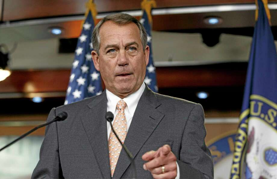 """Speaker of the House John Boehner is asked about the special select committee he has formed to investigate the deadly 2012 attack on the U.S. diplomatic post in Benghazi, Libya, raising the stakes in a political battle with the Obama administration as the midterm election season heats up, during a news conference on Capitol Hill in Washington, Thursday, May 8, 2014. The National Republican Congressional Committee has issued a fundraising pitch on its website asking people to become a """"Benghazi Watchdog"""" by donating money to GOP election efforts. Boehner has said that the examination would be """"all about getting to the truth"""" of the Obama administration's response to the attack and would not be a partisan, election-year circus. (AP Photo/J. Scott Applewhite) Photo: AP / AP"""
