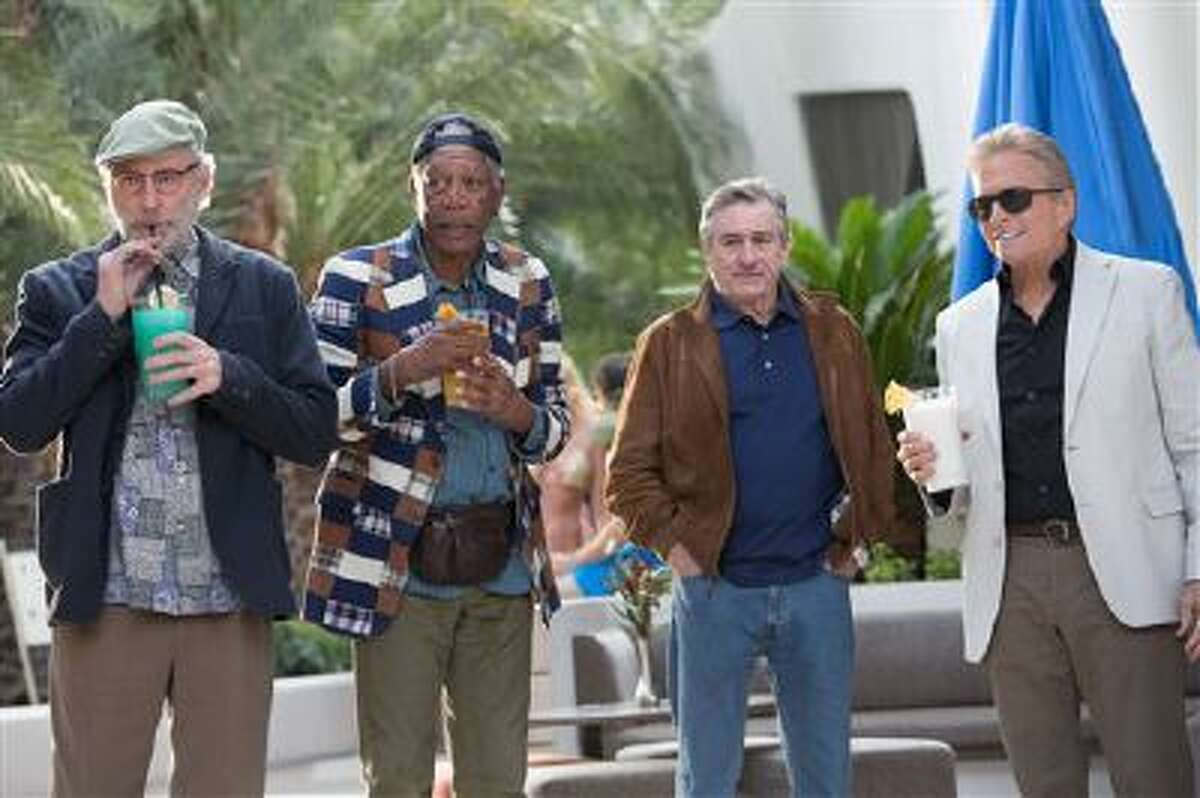 This image released by CBS Films shows, from left, Kevin Kline, Morgan Freeman, Robert De Niro and Michael Douglas in a scene from