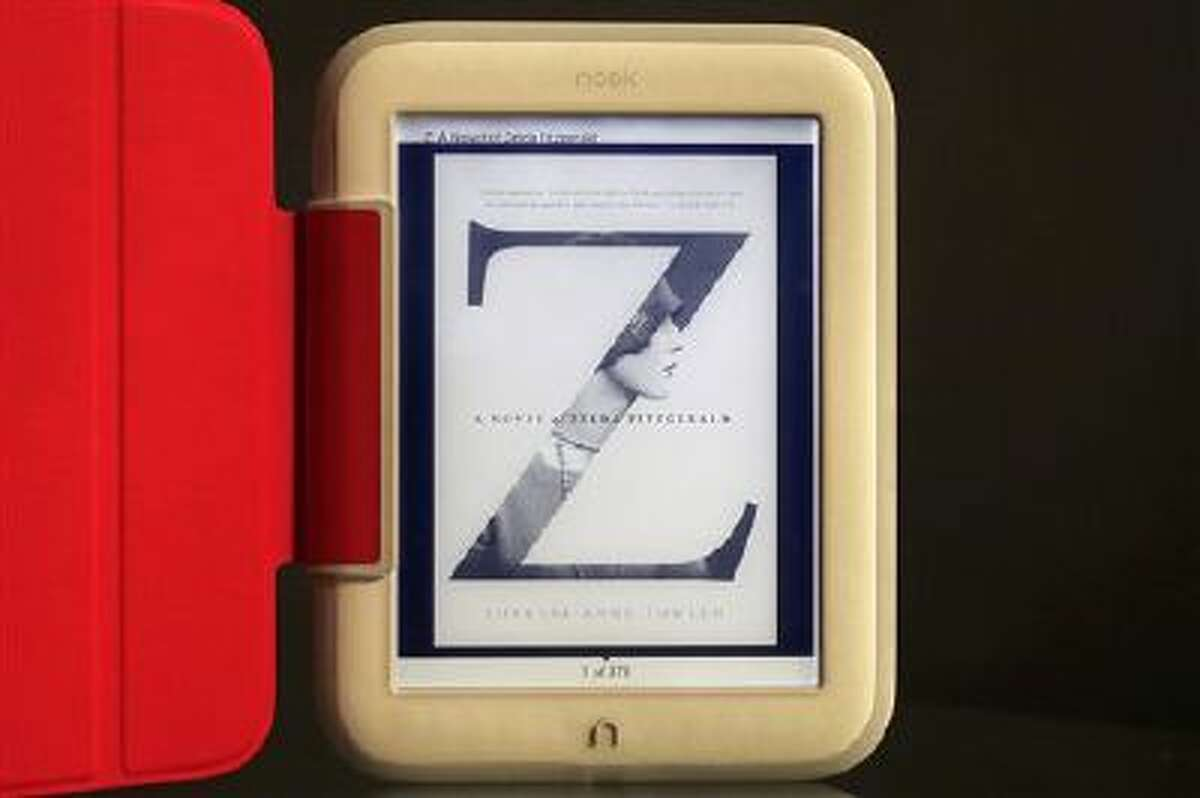In this Monday, Oct. 28, 2013 photo, Barnes & Noble's new e-reader, Nook GlowLight, is demonstrated in New York. Barnes & Noble Inc. is releasing a new Nook e-book reader for the holidays, while it evaluates the future of tablet computers. The red cover is an optional accessory.