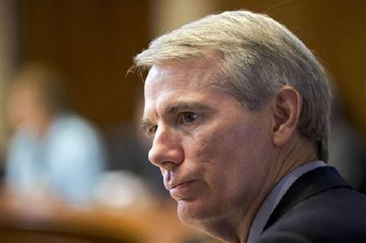 This photo made Thursday, March 21, 2013, shows Sen. Rob Portman, R-Ohio, on Capitol Hill in Washington. Portman who last month shook up the gay-marriage debate by announcing his support says he has been asked a lot about his shift while back home in Ohio. (AP Photo/J. Scott Applewhite)