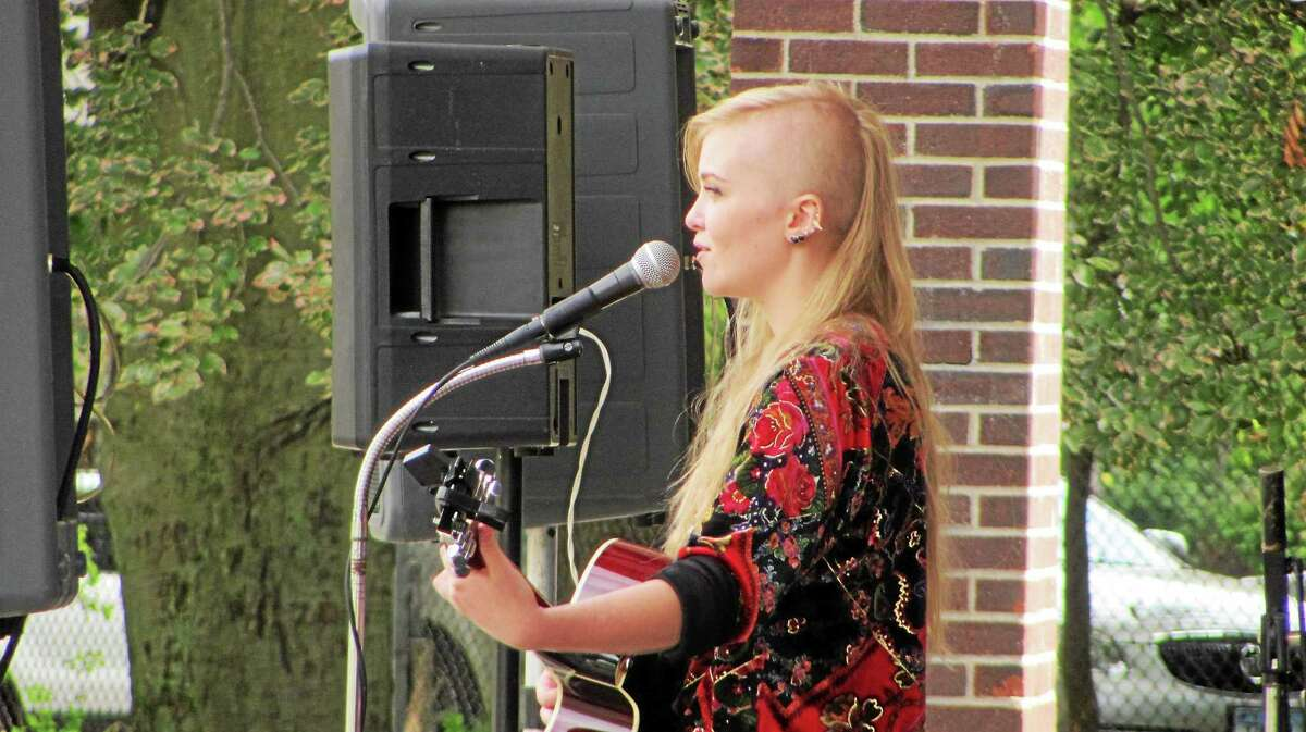 Julia Autum Ford of Winsted, shown at the Coe Park Unplugged folk music festival in Torrington Saturday, has a five-song album and will head out on a tour in October, a day after her 18th birthday.