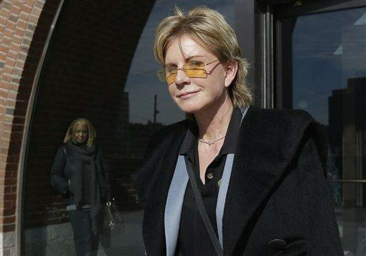 AP Photo/Steven Senne -- In a Feb. 7, file photo, author Patricia Cornwell leaves federal court in Boston after she took the stand in her lawsuit against her former financial management company. A federal jury awarded crime writer Patricia Cornwell nearly $51 million Tuesday, Feb. 19, in her lawsuit against her former financial management company and a former principal in the firm. Cornwell claimed that the firm and a former executive cost her millions of dollars in losses or unaccounted revenue during their four-year relationship.