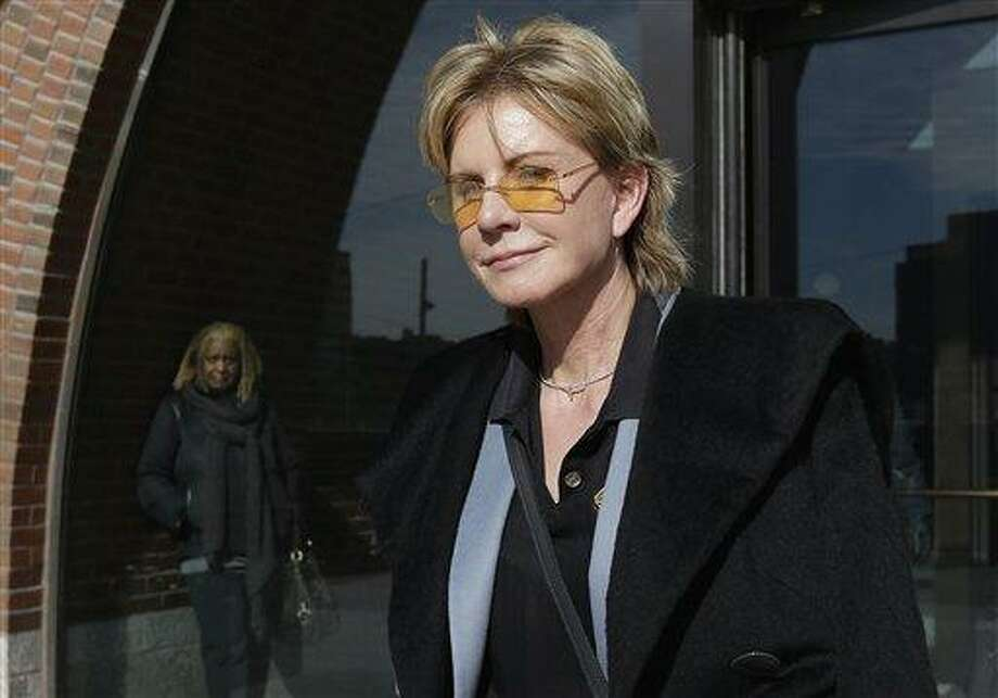 AP Photo/Steven Senne --  In a Feb. 7, file photo, author Patricia Cornwell leaves federal court in Boston after she took the stand in her lawsuit against her former financial management company.  A federal jury awarded crime writer Patricia Cornwell nearly $51 million Tuesday, Feb. 19, in her lawsuit against her former financial management company and a former principal in the firm. Cornwell claimed that the firm and a former executive cost her millions of dollars in losses or unaccounted revenue during their four-year relationship. Photo: AP / AP
