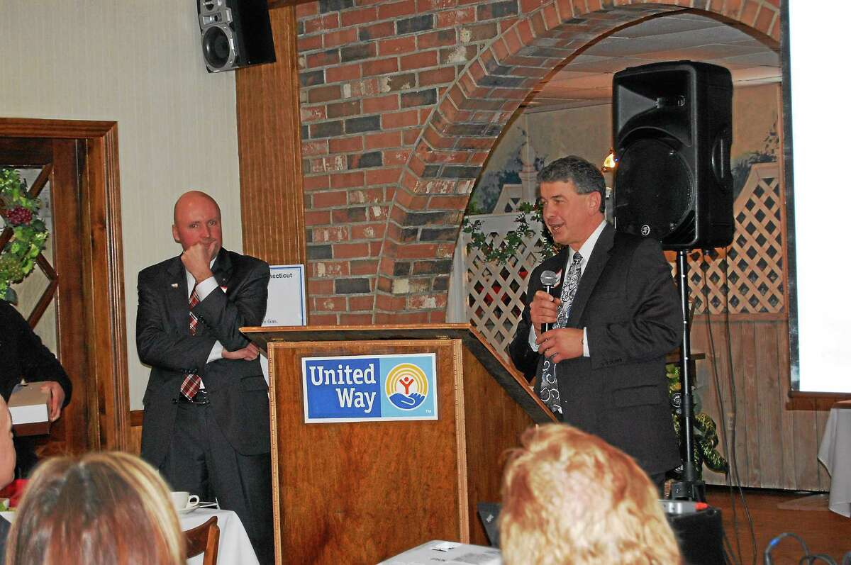 Retiring Chairman of the Board Paul McLaughlin, left, and new chairman Paul Rougeot speak during the annual meeting of the United Way of Northwest Connecticut Monday.