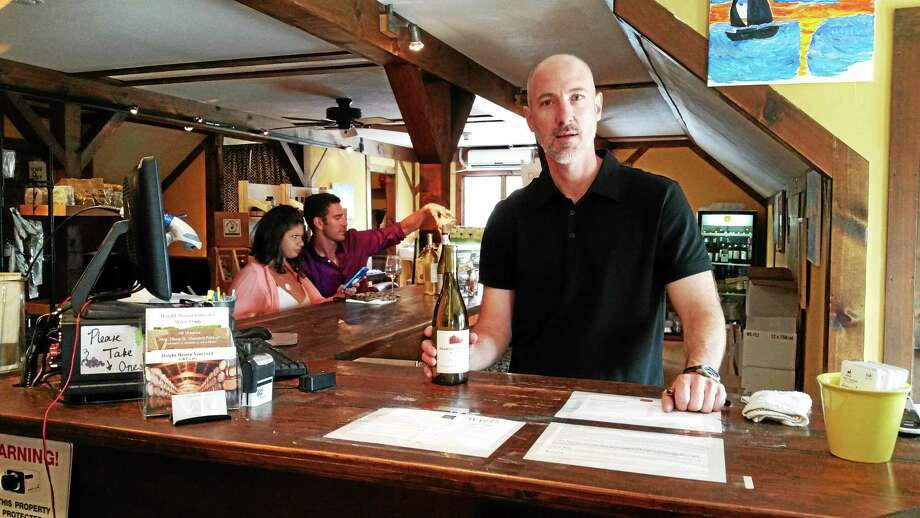 Volunteer bartender Paul Henderlite, 47, of Watertown, is ready to serve wine during wine tastings at the Haight-Brown Vineyards in Litchfield during the Harvest Festival Saturday. Photo: N.F. Ambery - Special To The Register Citizen