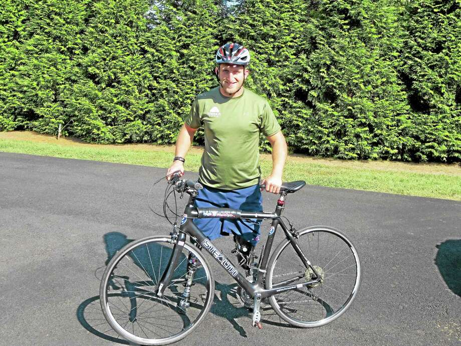 Marine veteran Rob Jones, who lost both of his legs while fighting in Afghanistan in 2010, is cycling cross country to raise money for veteran's charities. Photo: Contributed Photo