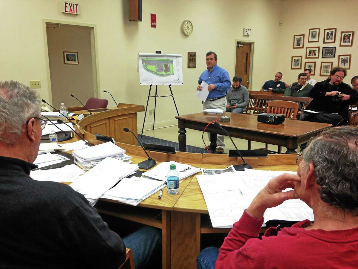 Traffic Engineer Scott Hesketh presents site plans on the proposed Dunkin and Donuts on 760 Main St. during a Winsted Planning and Zoning meeting Monday.